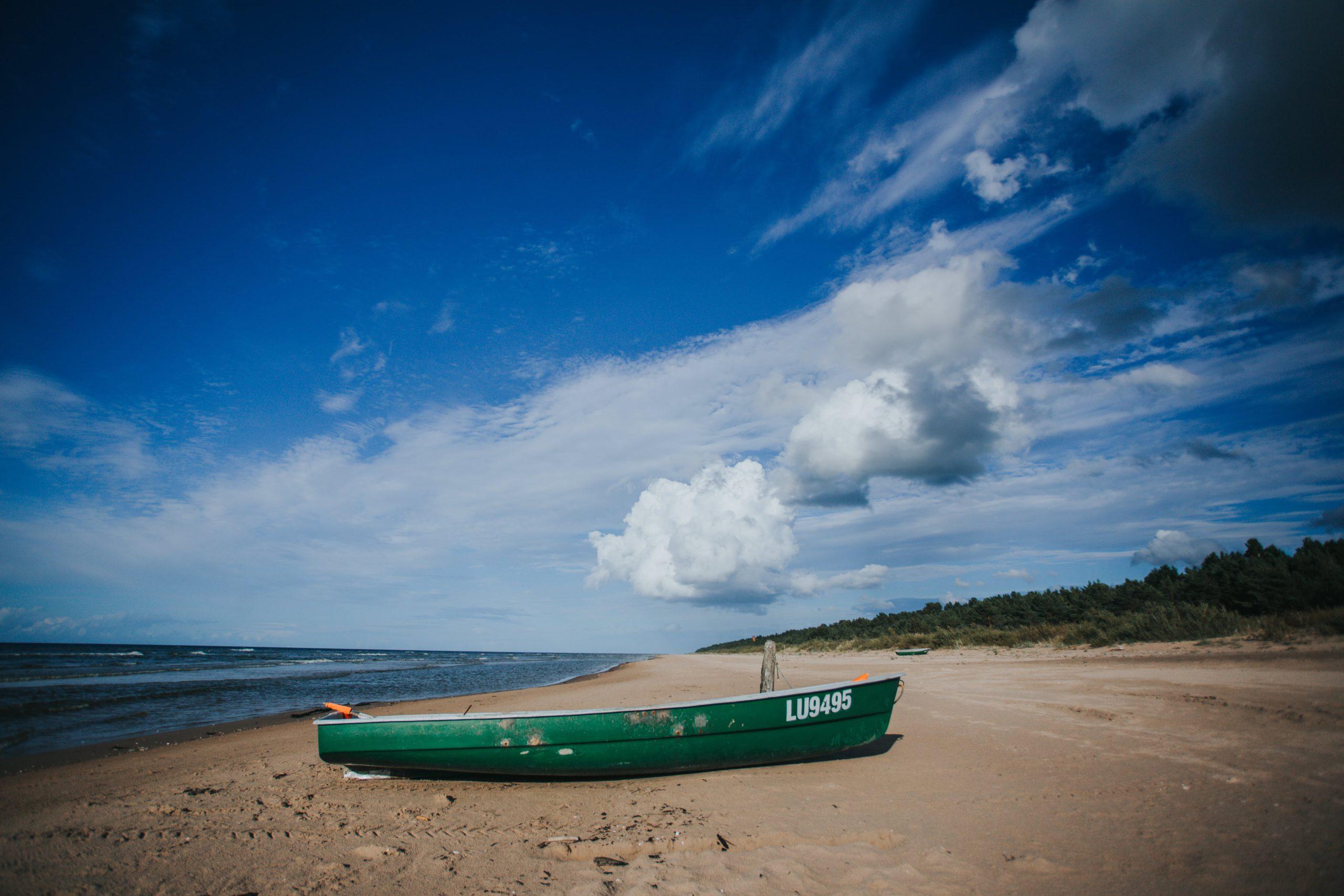 Holiday home Nitaiga boat on the beach